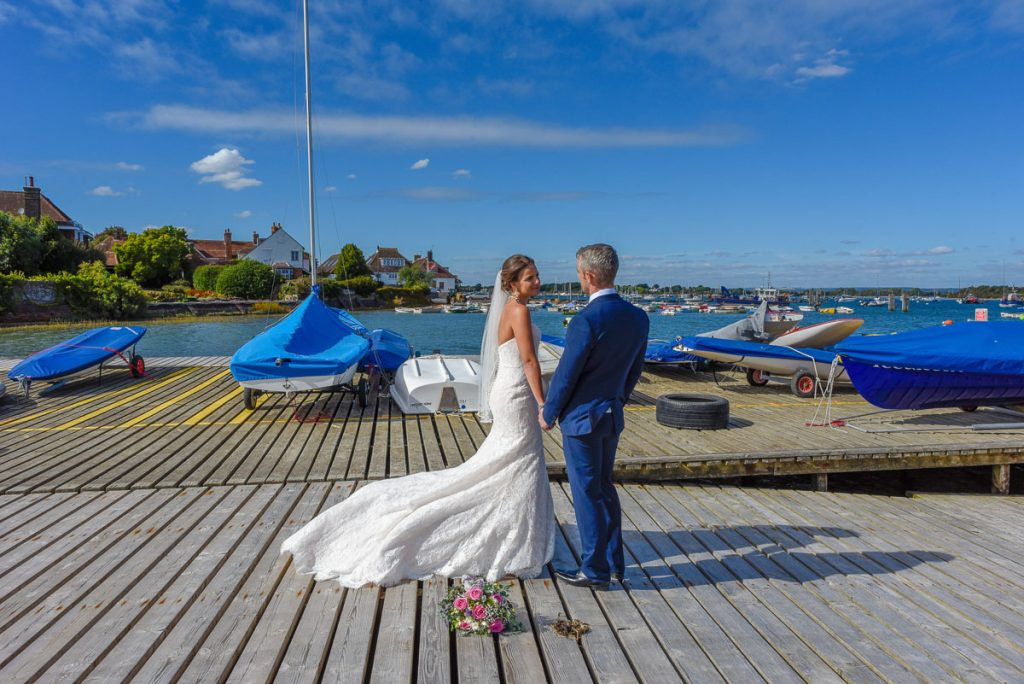 Bride and Groom have a moment to themselves at the beautiful Itchenor Sailing Club for a stunning seaside wedding