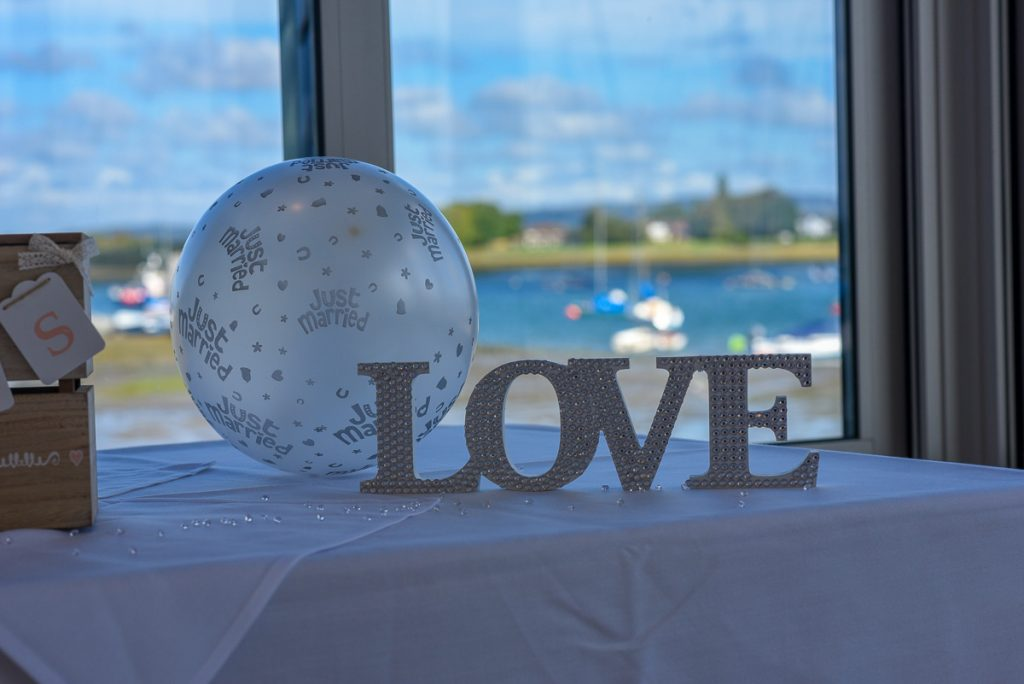 Love sign table decoration at the stunning itchenor sailing club with gorgeous sea views