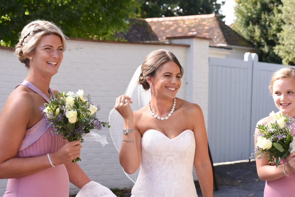 Bride maid of honour and bridesmaid having a few laughs before the ceremony at Itchenor Sailing Club