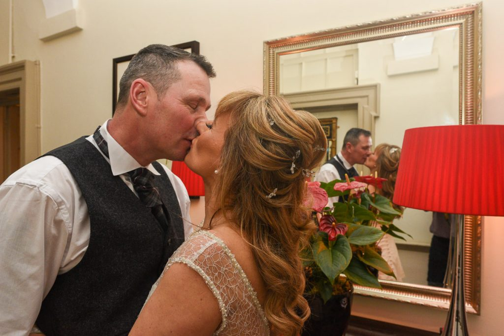 bride and groom enjoying a kiss at Sir Christopher Wren Hotel windsor
